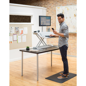man using standing workstation